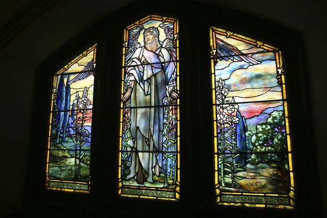In this Monday, March 26, 2018 photo, sunlight illuminates The Angel of Resurrection stained glass window by American artist Louis Tiffany at The Church of the Advent in Cincinnati. The church features stained glass by American artist Louis Tiffany. (Kareem Elgazzar/The Cincinnati Enquirer via AP)