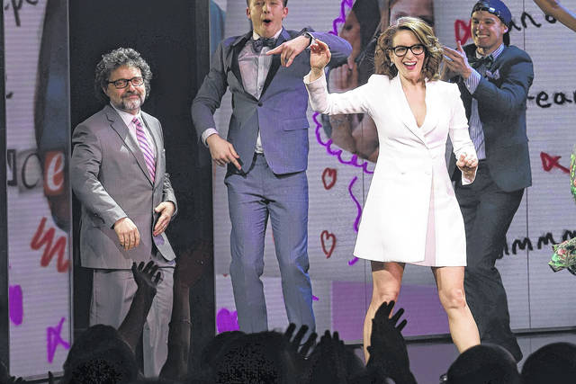 "Jeff Richmond, left, and Tina Fey participate in the curtain call for the ""Mean Girls"" opening night on Broadway at the August Wilson Theatre on Sunday in New York."