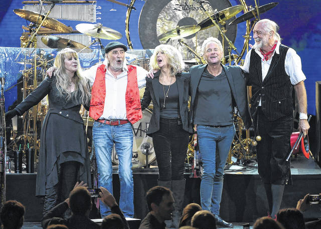 In this Jan. 26 photo, Fleetwood Mac band members, from left, Stevie Nicks, John McVie, Christine McVie, Lindsey Buckingham and Mick Fleetwood appear at the 2018 MusiCares Person of the Year tribute honoring Fleetwood Mac in New York. The band said in a statement Monday that Buckingham is out of the band for its upcoming tour. Buckingham left the group once before, from 1987 to 1996. He'll be jointly replaced by Neil Finn of Crowded House and Mike Campbell of Tom Petty and the Heartbreakers.