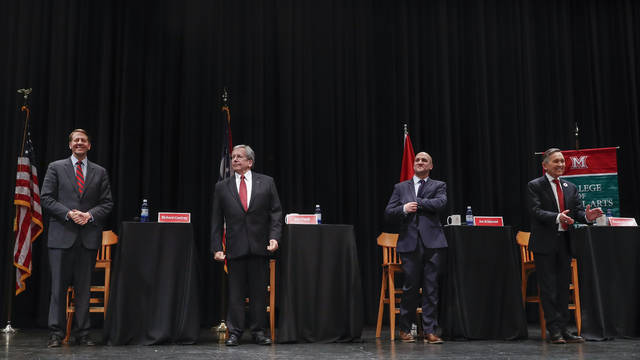 From left, Richard Cordray, former federal consumer protection chief; William O'Neill, former Ohio Supreme Court Justice; Ohio state Sen. Joe Schiavoni; and former U.S. Rep. Dennis Kucinich of Ohio stand at the start of the Ohio Democratic Party's fifth debate in the primary race for governor, Tuesday, April 10, 2018, at Miami (OH) University's Middletown campus in Middletown, Ohio. (AP Photo/John Minchillo)