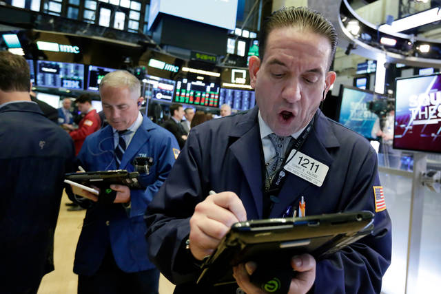 Trader Tommy Kalikas, right, works on the floor of the New York Stock Exchange, Monday, April 30, 2018. A burst of corporate deals and strong earnings reports helped push U.S. stock indexes higher in early trading Monday. (AP Photo/Richard Drew)