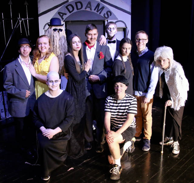 Pictured are Austin Horstman (Uncle Fester), Craig Recker (Pugsley), Alex Hoehn (Mr. Beineke), Kadie Hempfling (Mrs. Beineke), Kendra Kahle (Morticia), Nathan Arrington (Gomez), Jessi Schriner (Wednesday), Seth Nelson (Lucas Beineke), Morgan Maag (Grandma) and Riley Karhoff (Lurch). The show is under the direction of Linda Knowlton with musical director Jo Deskins and choreographer Kristen Gerding-Heffner.