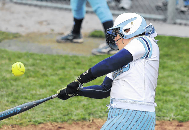 Bath's Tara Cooper makes contact while at bat during Thursday's game against Napoleon at Bath High School.