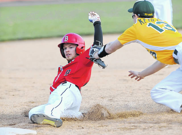 Bluffton's Dakota Bricker is tagged out at third base by Ottoville's Dylan Kemper during Wednesday's game in Bluffton.
