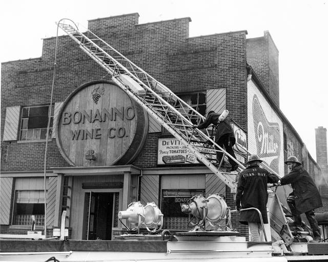 This photo shows 1957 shows firemen fighting the fire at Bonanno Wine Co. on North West Street. The family started selling fruit and operating a grocery in the early 1900s, a business that was later run by the immigrant's sons.