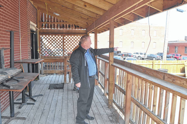 Sam McLean discusses plans for the deck outside of the new bar/restaurant on 318 N. Main. St. in downtown Lima.