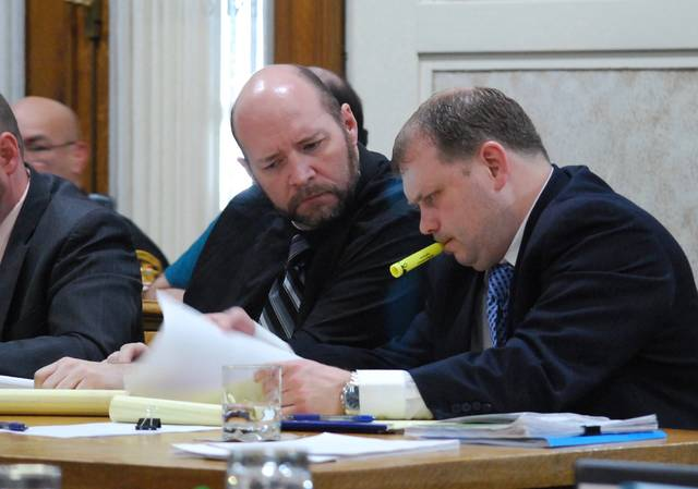 J Swygart | The Lima News  Tony Sheldon confers with defense attorney Rocky Ratliff as Sheldon's trial entered its second week Monday in Hardin County Common Pleas Court. Jury deliberations will begin Tuesday.