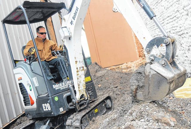 Jeff Blanford excavates an alley downtown. His 10,000 square foot project downtown includes a restaurant, a brewery and a banquet hall. Blanford is one of the few private investors in Lima's downtown.