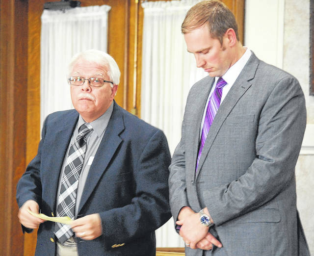 Former Allen East band director Dennis Dellifield, left, read a letter of apology to his family, to his victims and their families and to the Allen East community during his sentencing hearing Thursday in Hardin County Common Pleas Court. Dellifield was sentenced to 90 days in jail and five years on probation for requesting two young boys send him photos of their genitalia.