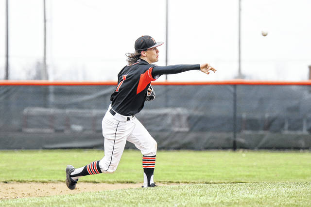 Elida's Noah Adcock of Elida throws out an Ottawa-Glandorf runner at first base during Friday's game at Ed Sandy Field.