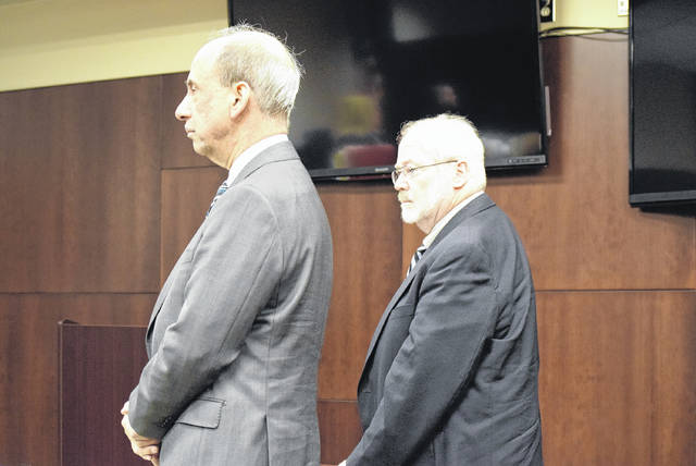 Dr. James Gideon, right, stands next to his attorney Dennis Belli as he's found guilty of three out of the five counts against him.