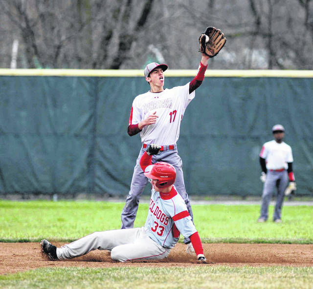 Columbus Grove's Dane Schroeder slides into second with a stolen base as Lima Senior's Hunter Smith receives the throw during Saturday's doubleheader at Lima Senior.