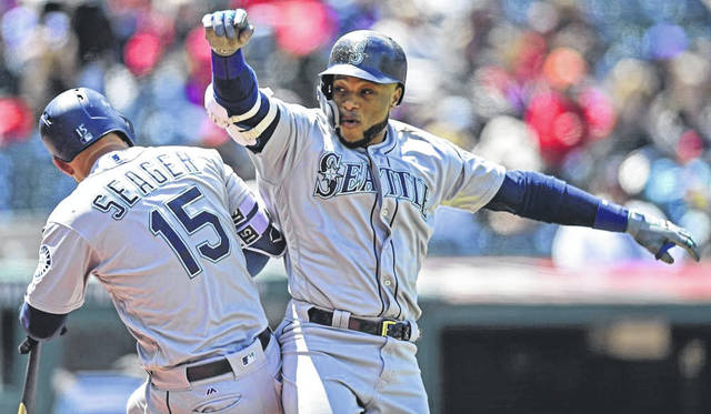 Robinson Cano, right, of the Seattle Mariners, celebrates with Kyle Seager after hitting a two-run home run off Cleveland Indians starting pitcher Josh Tomlin in the second inning of Sunday's 10-4 Mariners win.