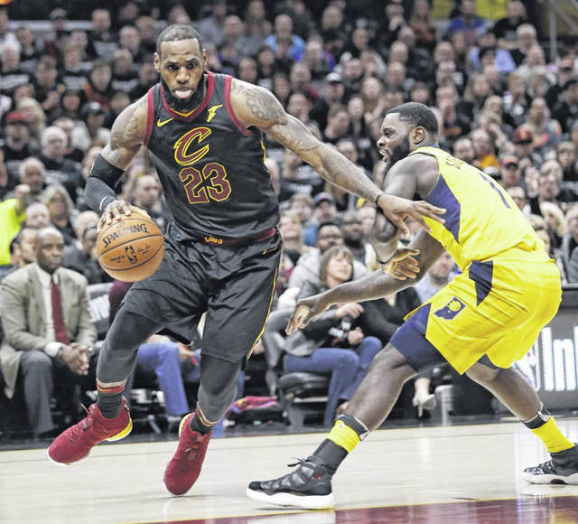 LeBron James, left, drives past the Indiana Pacers' Lance Stephenson in the first half of Game 7 of an NBA basketball first-round playoff series on Sunday in Cleveland.