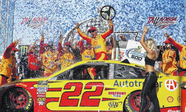 Joey Logano celebrates in victory lane after winning the NASCAR Talladega auto race at Talladega Superspeedway in Talladega, Ala., on Sunday.
