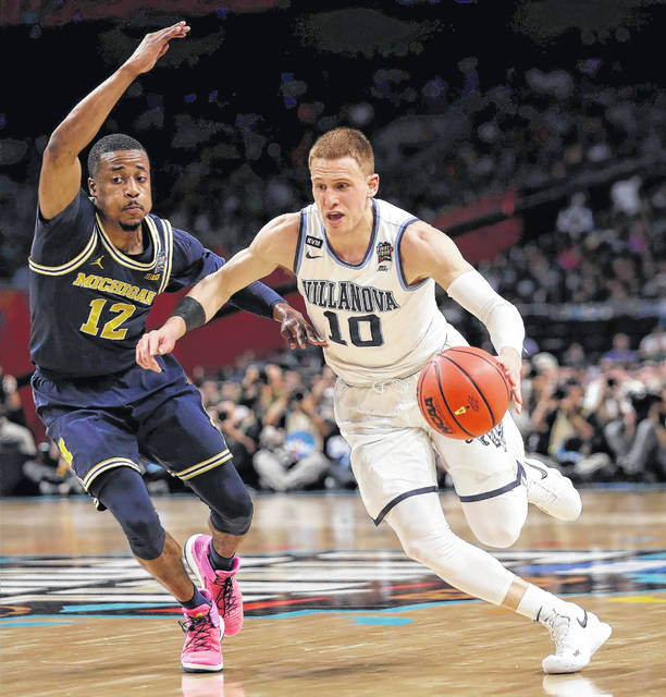 Villanova's Donte DiVincenzo (10) drives past Michigan's Muhammad-Ali Abdur-Rahkman (12) during the first half in the championship game of the Final Four NCAA college basketball tournament, Monday, April 2, 2018, in San Antonio.