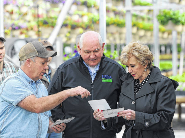 From left: Adin Horst, U.S. Secretary of Agriculture Sonny Perdue, and Mary Ruff tour The Amherst Greenhouse in Harrod on Wednesday morning.