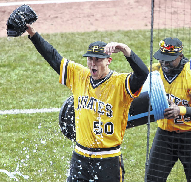 Pittsburgh Pirates starting pitcher Jameson Taillon, left, reacts after being doused by teammate Gregory Polanco as he waits to be interviewed after throwing a complete game, one-hit shutout against the Cincinnati Reds in Pittsburgh on Sunday.