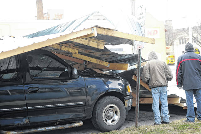 High winds took off the roof of the Royal Inn that landed on top of a pickup truck on South Pierce Street on Wednesday morning.