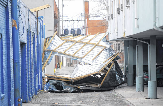 High winds took off the roof of the Royal Inn at 418 W. Market St. Wednesday morning.