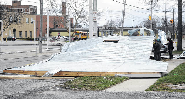 Part of the roof landed in the street by the motel.