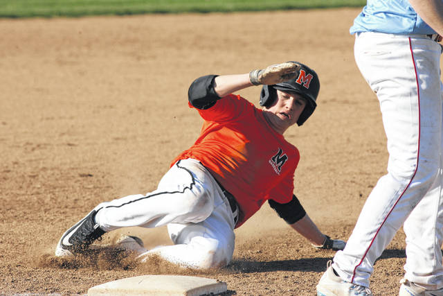 Minster's Jack Olberding slides safely into second base against Lima Central Catholic after a wild pitch at Lima Central Catholic Friday.
