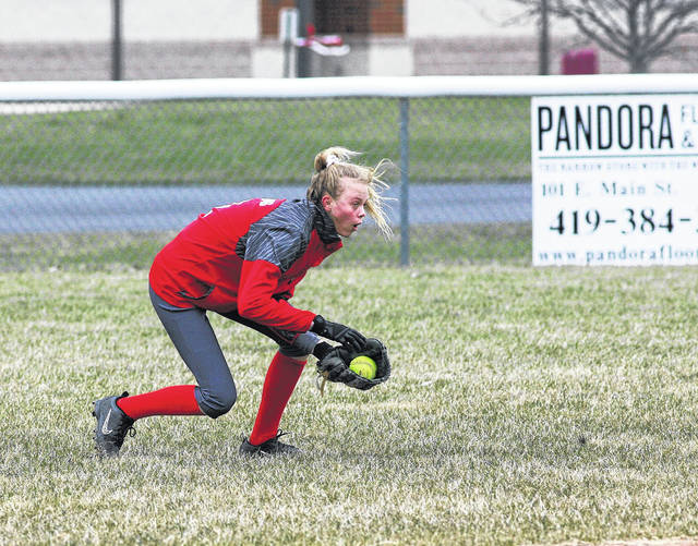 Pandora-Gilboa's Taylor Schawb fields a ball in the outfield during Friday's game against Bluffton at Pandora-Gilboa.