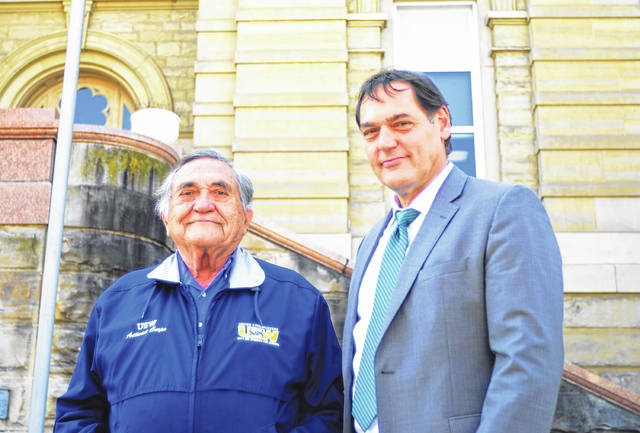 Ohio Auditor Candidate Zack Space (right) and his father, Socrates (left), stand in front of the Allen County Courthouse during a campaign stop in Lima.