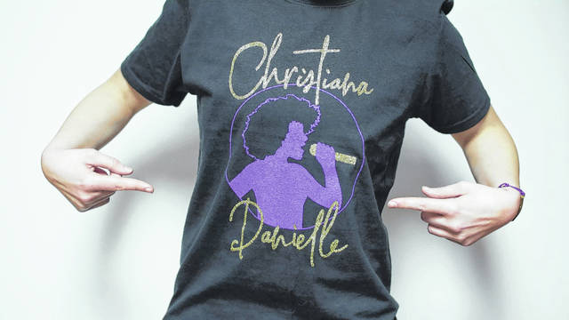 "Photo provided Elida native Kayla Lane designed this T-shirt for Christiana Danielle, a contestant on ""The Voice."""