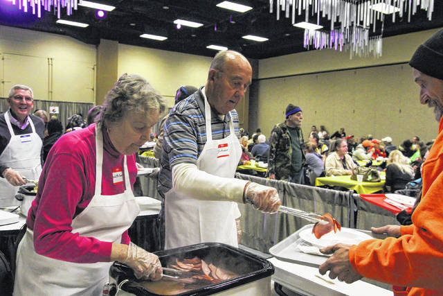 Willetta Knepper (left) and Don Knepper volunteer for the 2nd year at the Tom Ahl Easter Dinner held at the Lima Civic Center on Easter Sunday.