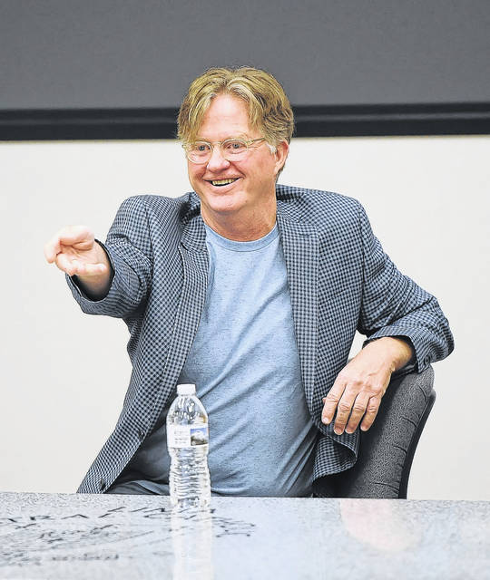 Tom Flynn, A Lima native, screenwriter and LCC Hall of Fame speaks during a a master class at Lima Central Catholic on Thursday.  Richard Parrish | The Lima News