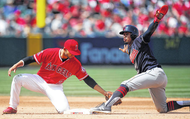 Cleveland Indians' Francisco Lindor, right, gestures after stealing second base against Los Angeles Angels' Andrelton Simmons during the fifth inning of a baseball game Wednesday, April 4, 2018, in Anaheim, Calif. (AP Photo/Jae C. Hong)