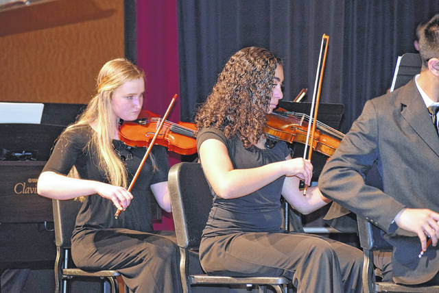Noelle Webb, left and Marina Shenouda, right. perform with the Lima Area Youth Orchestra Sunday night.