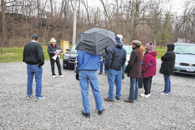 Around a dozen people turned out Saturday for another protest by Cable-TV-War, a group led by Ned Bushong who want to see cable TV rates lowered.