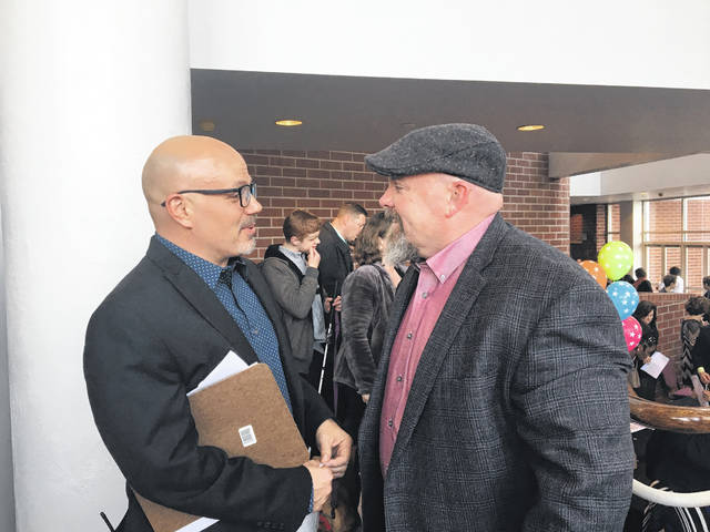 "Nick Kellis, writer, director and producer of the movie, ""A Walk With Grace,"" chats with a friend before the sneak peek preview at the Civic Center."