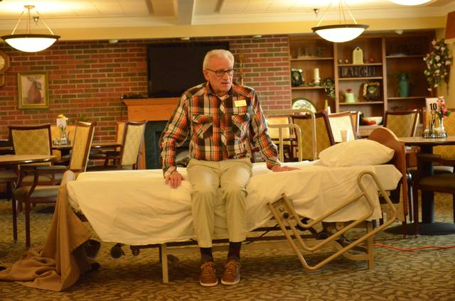 Bryan Reynolds   The Lima News Bob Kann demostrates techniques for getting out of bed to members of the Parkinson's Activity and Rehabilitation Klinic (PARK) Program. PARK celebrates its 30th anniversary this year and recently received a $2,000 donation from the Parkinson's Foundation of Ohio.