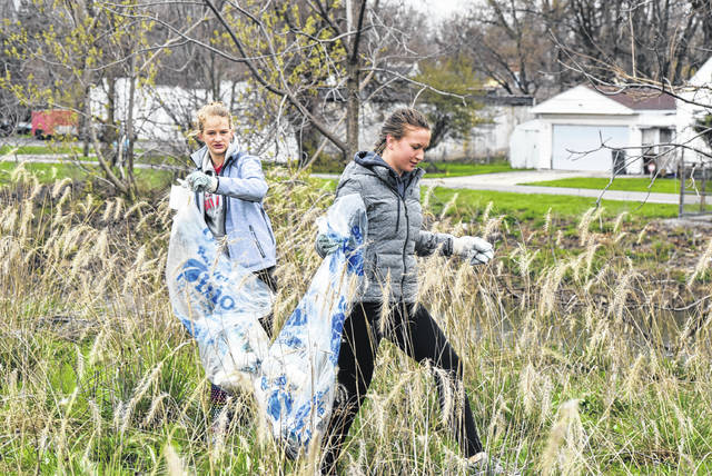 Ellie Hahn and Katie Curl from Shawnee Middle School participate in the Ottawa River Cleanup Saturday.