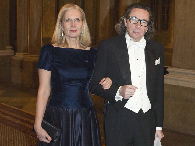 Swedish Academy member Katarina Frostenson, left, and photographer Jean Claude Arnault attend the Kings Nobel dinner at the Royal Palace in Stockholm in 2011. The Nobel Prize in literature will be not awarded this year following sex-abuse allegations and other issues within the ranks of the Swedish Academy that selects the winner. The Swedish Academy's internal feud was triggered by an abuse scandal linked to Arnault, a major cultural figure in Sweden.
