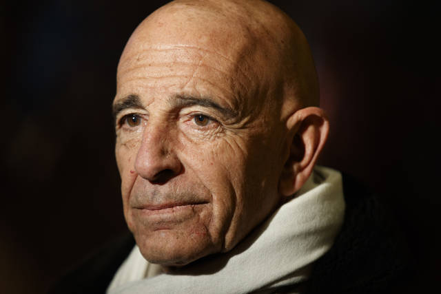 FILE - In this Jan. 10, 2017 file photo, Tom Barrack, chairman of the inaugural committee, speaks with reporters in the lobby of Trump Tower in New York. The Associated Press has learned that investigators working with special counsel Robert Mueller have interviewed Barrack. Two people familiar with the probe tell the AP that Barrack met with federal investigators working on the Russia inquiry. The people spoke on condition of anonymity to discuss private deliberations. Barrack spokesman Owen Blicksilver declined comment.