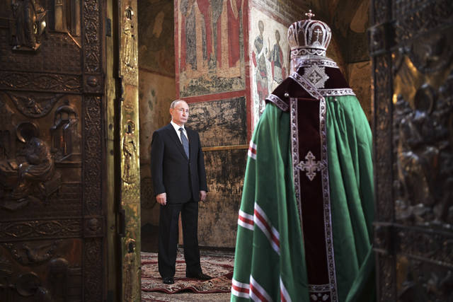 Russian President Vladimir Putin attends a service held by Russian Orthodox Patriarch Krill, right, in the Annunciation Cathedral after the inauguration ceremony in the Kremlin in Moscow, Russia, on Monday, May 7, 2018. Putin took the oath of office for his fourth term as Russian president on Monday and promised to pursue an economic agenda that would boost living standards across the country. (Alexei Nikolsky, Sputnik, Kremlin Pool Photo via AP)