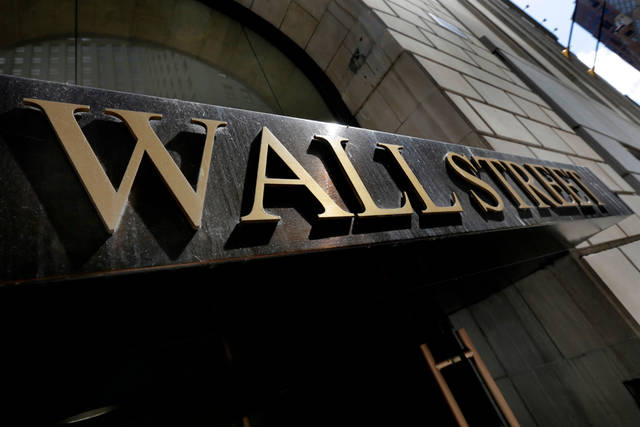 FILE - This April 5, 2018 file photo shows a building's address on Wall Street, in New York.  Stocks are opening slightly lower on Wall Street, Tuesday, May 8, 2018, as the market gives back some of the gains it made the day before.   (AP Photo/Richard Drew)