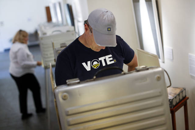 John Hopkins votes at his local precinct on primary election day, Tuesday, May 8, 2018, in Cincinnati. Ohio's roller-coaster gubernatorial primary season will be decided Tuesday as Republicans and Democrats vote for their nominees to replace term-limited Republican Gov. John Kasich. (AP Photo/John Minchillo)