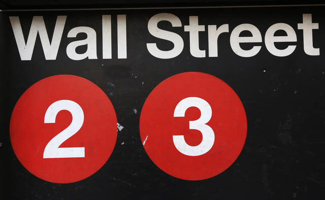 FILE - This Friday, Jan. 15, 2016, file photo shows a sign for a Wall Street subway station in New York.  Stocks are opening broadly higher on Wall Street, Wednesday, May 9, 2018, led by gains in energy companies as the price of crude oil moved back above $70 a barrel.  (AP Photo/Mark Lennihan, File)
