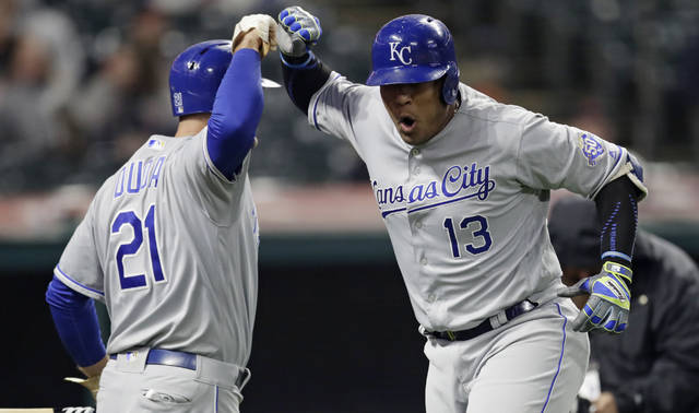Kansas City Royals' Salvador Perez, right, and Lucas Duda celebrate after Perez hit a two-run home run off Cleveland Indians relief pitcher Andrew Miller during the seventh inning of a baseball game Friday, May 11, 2018, in Cleveland. (AP Photo/Tony Dejak)