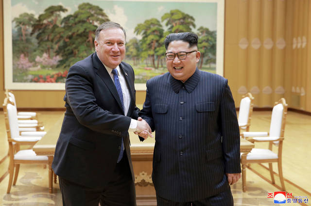 "In this Wednesday, May 9, 2018, file photo provided by the North Korean government, U.S. Secretary of State Mike Pompeo, left, shakes hands with North Korean leader Kim Jong Un during a meeting at Workers' Party of Korea headquarters in Pyongyang, North Korea. Independent journalists were not given access to cover the event depicted in this image distributed by the North Korean government. The content of this image is as provided and cannot be independently verified. Korean language watermark on image as provided by source reads: ""KCNA"" which is the abbreviation for Korean Central News Agency. (Korean Central News Agency/Korea News Service via AP, File)"