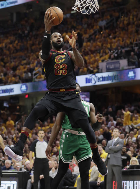 Cleveland Cavaliers' LeBron James (23) shoots against the Boston Celtics in the first half of Game 3 of the NBA basketball Eastern Conference finals, Saturday.