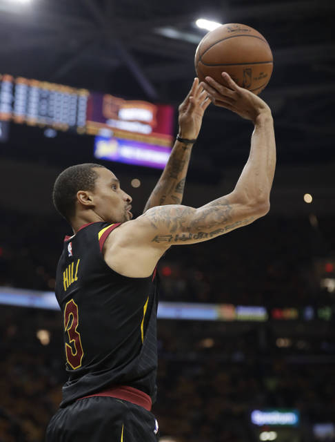 Cleveland Cavaliers' George Hill (3) shoots against the Boston Celtics in the first half of Game 3 of the NBA basketball Eastern Conference finals, Saturday, May 19, 2018, in Cleveland. (AP Photo/Tony Dejak)