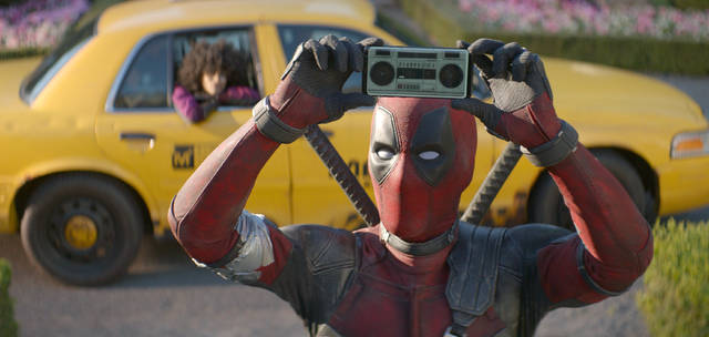 """FILE - This image released by Twentieth Century Fox shows Ryan Reynolds in a scene from """"Deadpool 2."""" Fox's """"Deadpool 2"""" brought in $125 million according to studio estimates Sunday, May 20, 2018, and ended the three-week reign of Disney's """"Avengers: Infinity War"""" at the top of the North American box office. (Twentieth Century Fox via AP, File)"""