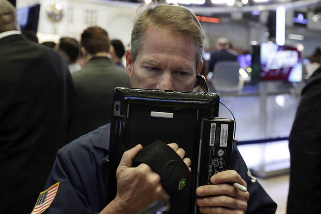 Trader Robert Charmak works on the floor of the New York Stock Exchange, Tuesday, May 22, 2018. U.S. stocks are making modest gains as energy companies rise with oil prices and banks also move higher. (AP Photo/Richard Drew)