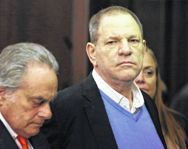 Harvey Weinstein, right, appears at his arraignment with his lawyer, Benjamin Brafman, in Manhattan Criminal Court on Friday. Weinstein is charged with two counts of rape and one count of criminal sexual act. He was released on $1 million bail.